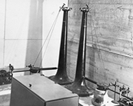 The horizontal pendulum north-south and east-west in the 1935 Seismograph Room. Photo: UAF Rasmuson Library Archives