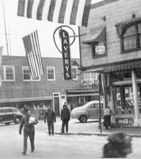 Photograph of Lavery's Grocery Store with flags waving in preparation for the Winter Carnival around 1946-1948. Photo: University of Alaska Rasmuson Library, Cecil H. Kornegay Photograph Collection