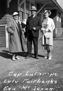 Lulu Fairbanks, Austin E. (Cap) Lathrop, and Eva McGowan standing together in Fairbanks. Anchorage Museum at Rasmuson Center.